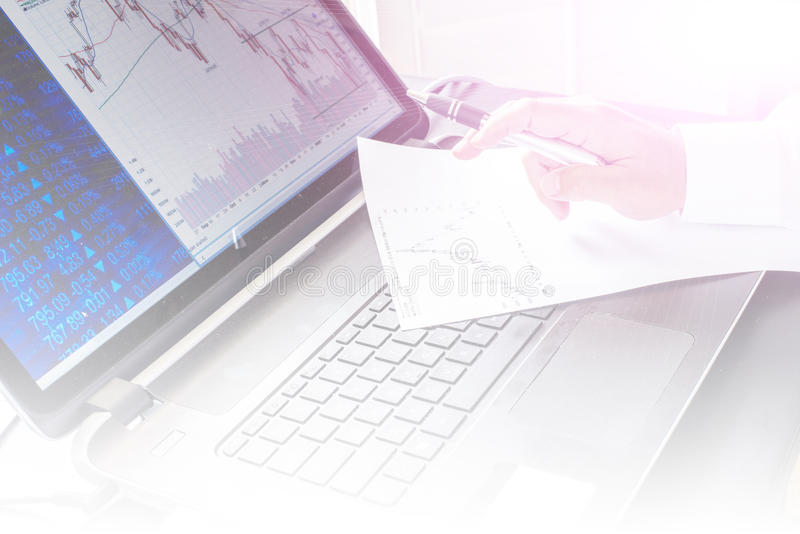 Business person working on compute. With chart stock image