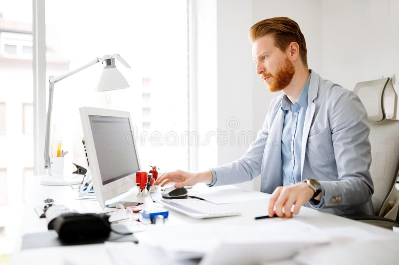Business person working on computer. At his office desk royalty free stock photo