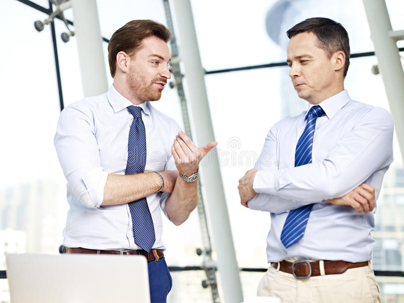 Business persons chatting in office royalty free stock images