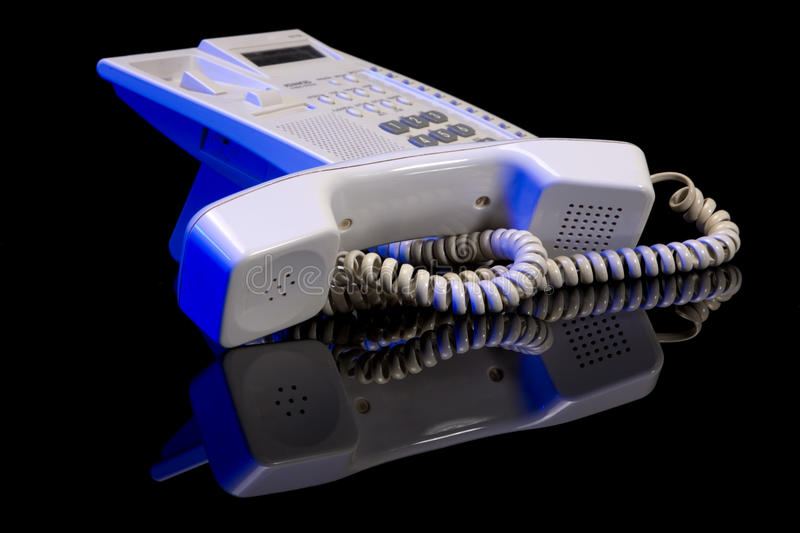 Business phone. Close up on black background stock images