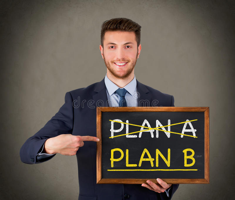 Business Plan on Chalkboard Pointing Businessman royalty free stock photo