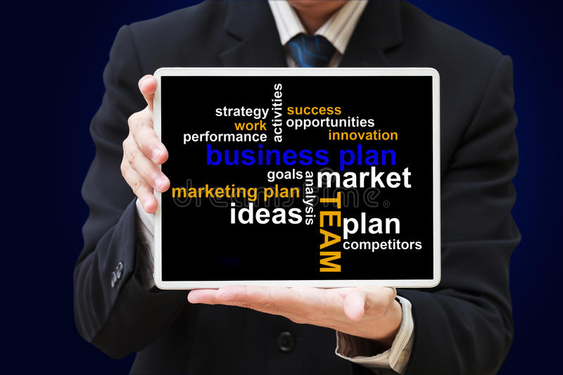 Business plan chart. Business man show touch screen tablet with business plan chart royalty free stock images