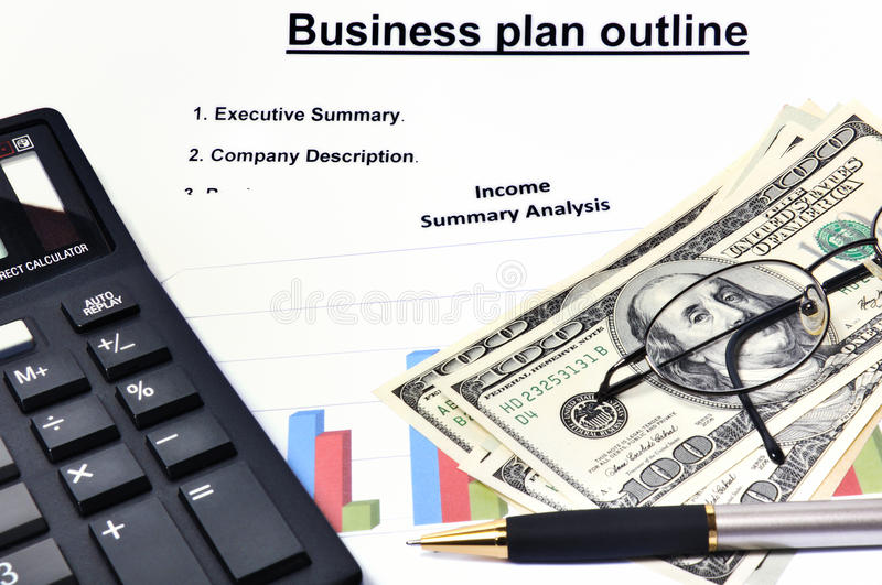 Business plan with graphical analysis and money royalty free stock image