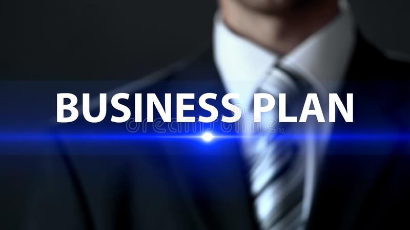 Business plan, male in suit standing in front of screen business development royalty free stock photography