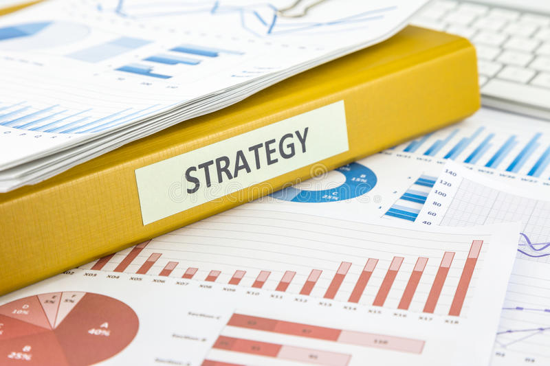 Business plan marketing strategy with graph analysis. Binder of marketing strategy documents and graphs analysis from business survey reporting royalty free stock photography
