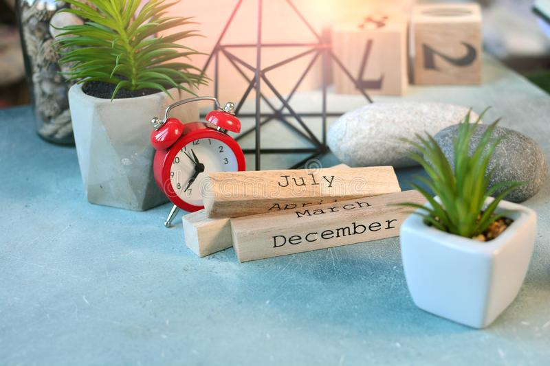 Business planning concept still life with month calendar cubes, clock, flowers and other decor in scandinavian style. Business planning concept still life with stock image