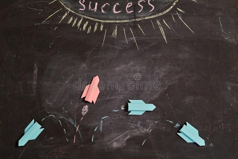 Business planning. Strategy. Challenge, improvment and progress concept. Red rocket changing the trajectory of life.  royalty free stock photography