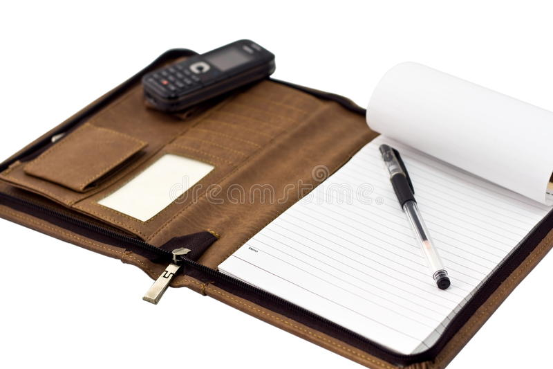 Business pocketbook. Open business pocketbook and mobilphone on white stock photo