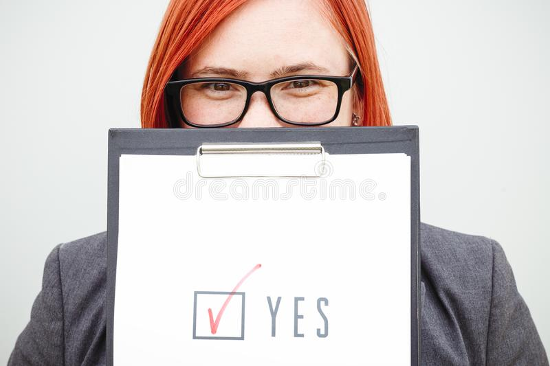 Business politics concept of choice and voting. Woman in suit an royalty free stock image