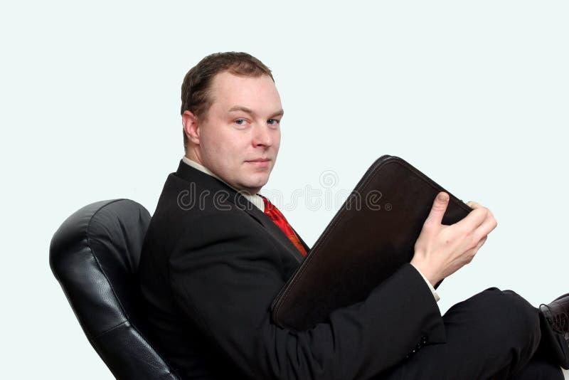Business presentation. A business man preparing for a presentation stock photo