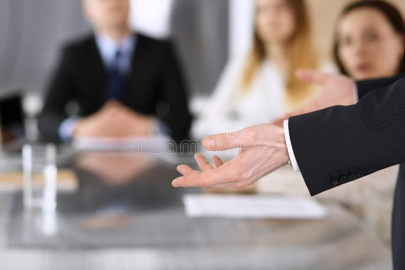 Business presentation. Businessman giving speech to colleagues and partners at corporate meeting or conference, close-up stock image