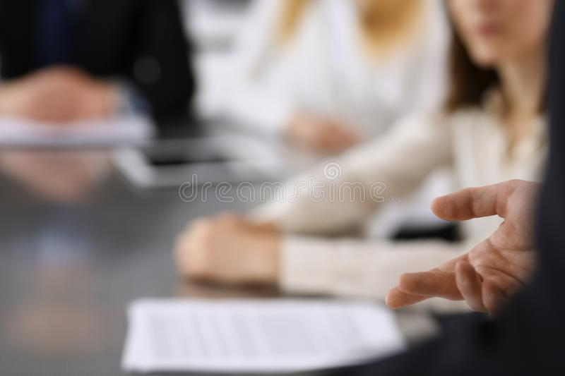 Business presentation. Businessman giving speech to colleagues and partners at corporate meeting or conference, close-up stock images