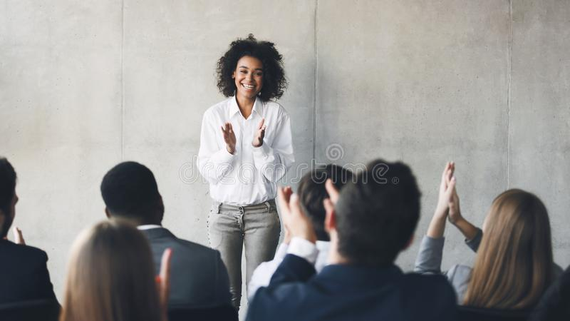 Business presentation. Grateful audience clapping hands to speaker stock photo