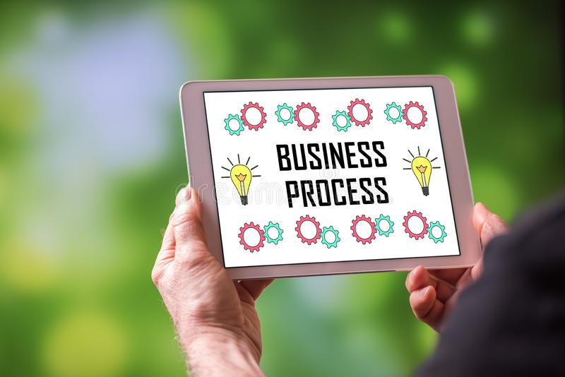Business process concept on a tablet royalty free stock photo