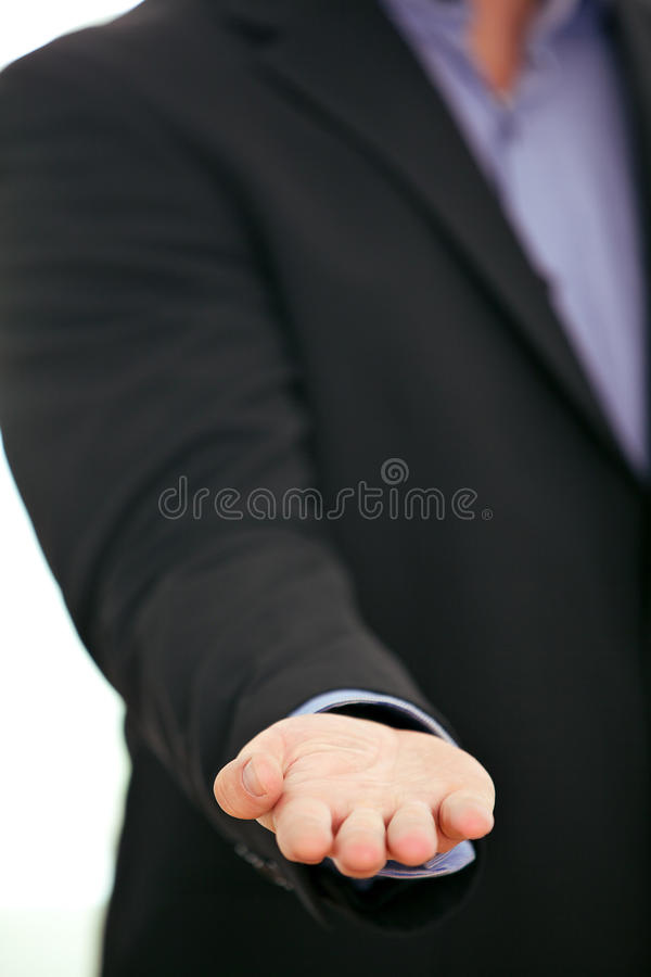 Business product placement. Cropped view image of the hand of a businessman with his empty palm upwards for placement of a business product or in a begging royalty free stock photos