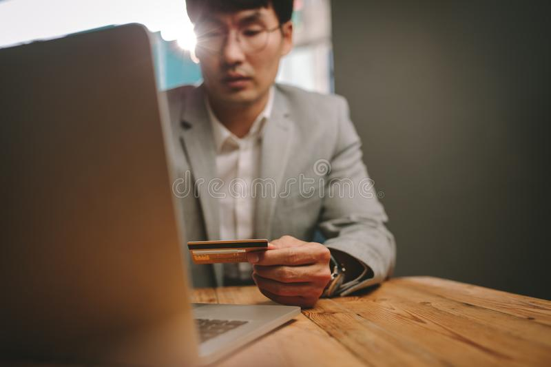 Business professional doing online payment stock image
