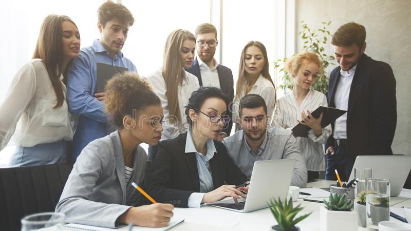 Business professionals analyzing data on laptop in office royalty free stock photos