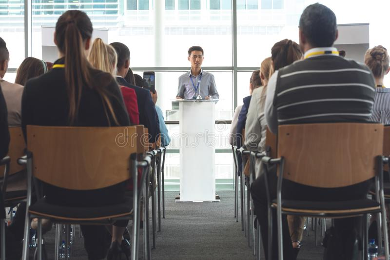 Business professionals attending a seminar stock images