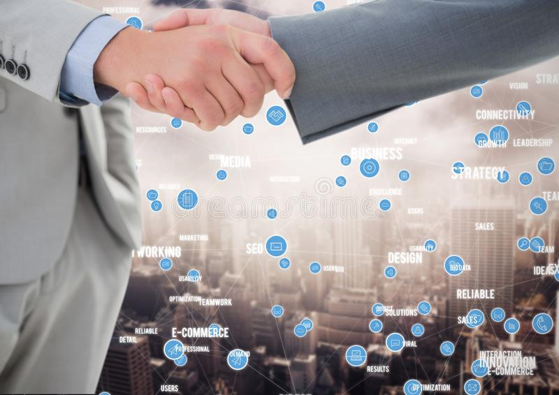 Business professionals shaking hands against networking icons in background. Digital composition of business professionals shaking hands against networking icons royalty free stock photos