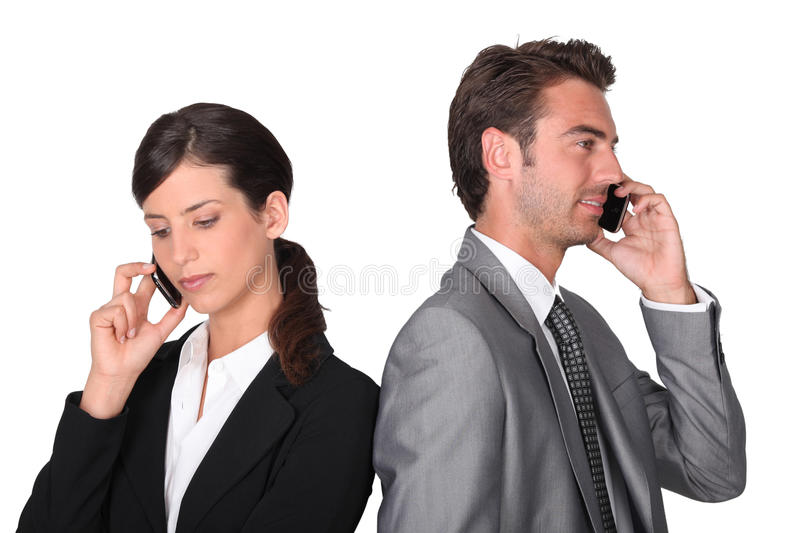 Business professionals talking. To their better halves royalty free stock image