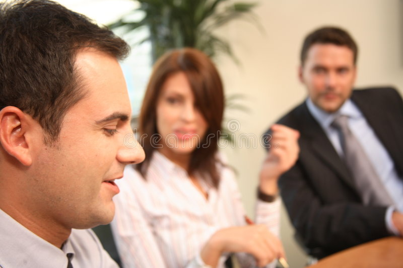 Business professionals talking at the meeting stock images