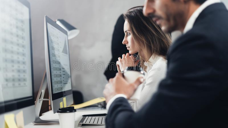 Two young business professionals working process at office.Young professionals work with new market project on desktop. Business professionals working process at stock photo