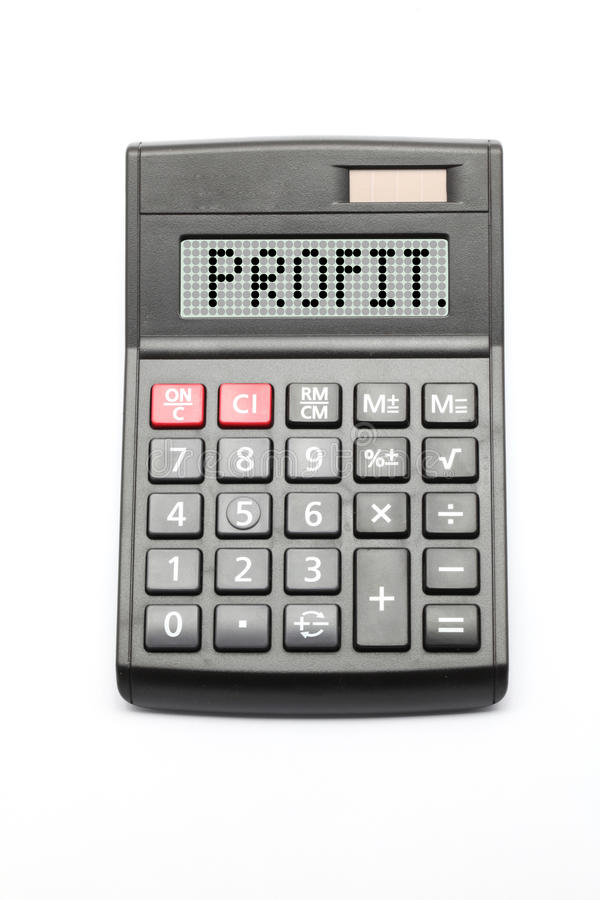 Business Profit. Calculator on white background stock photo