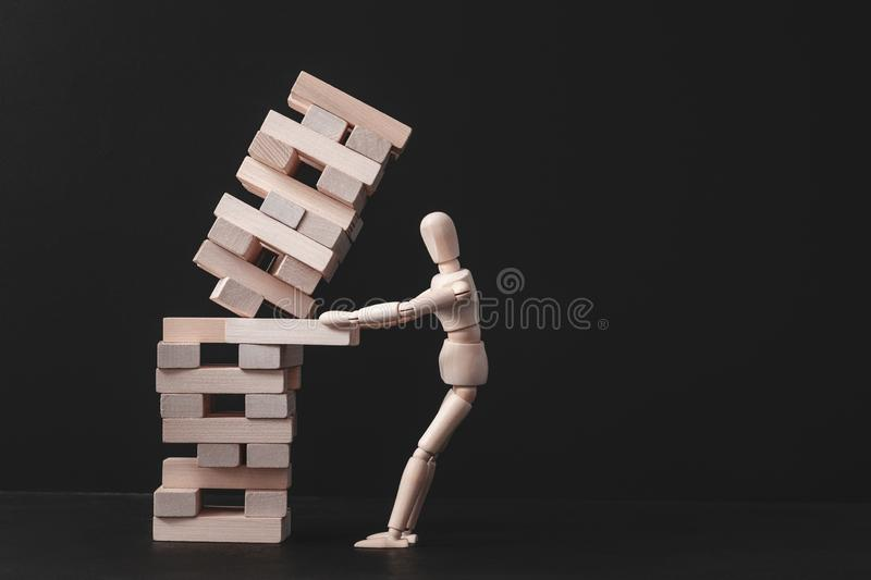 Business project strategy mistake risk failure. Business project. Strategy mistake. Risk and failure. Falling tower stack. Conceptual articulated mannequin royalty free stock photography