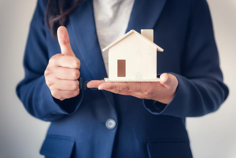 Business Property Selling and Estate Investment Concept, Close-Up Portrait of Business Woman in Suit Showing House Model With royalty free stock photography
