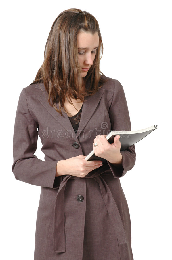 Business Proposal. Business woman or student looks down at her business proposal. Vertical crop on white background stock photo