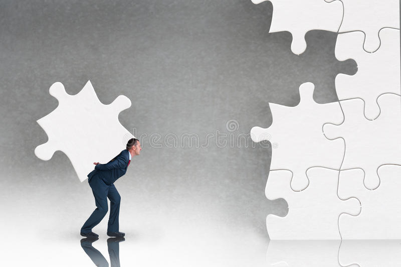 Business puzzle concept with businessman and jigsaw royalty free stock image