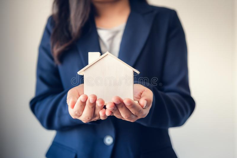 Business Real Estate and Residential Investment Concept, Broker Sell Agency Advisor of Property Estates Handover New Housing to. Customers While Holding House stock photography