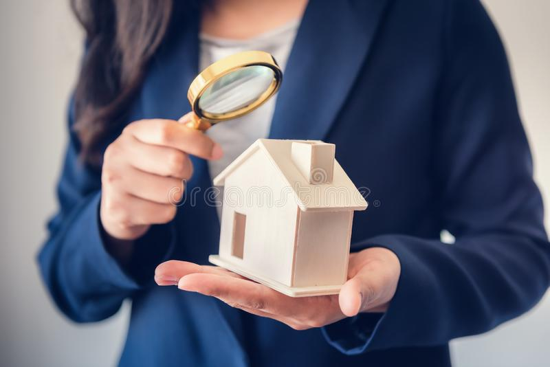 Business Real Estate and Residential Investment Concept, Broker Sell Agency of Property Estates Investigation By Magnifying Glass. For Searching New Housing to royalty free stock photos
