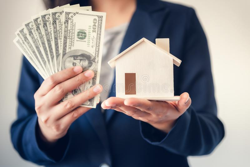 Business Real Estate and Residential Investment Concept, Broker Sell Agency of Property Estates Showing Money and House Model to. Customer. Business Financial royalty free stock photo