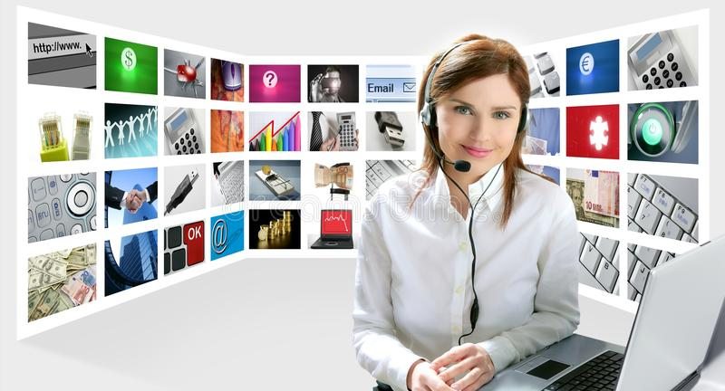 Business redhead beautiful woman headphones royalty free stock photos