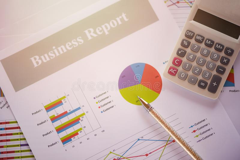 Business report chart preparing graphs calculator concept Summary report in Statistics circle Pie chart on paper business document. Business report chart royalty free stock image