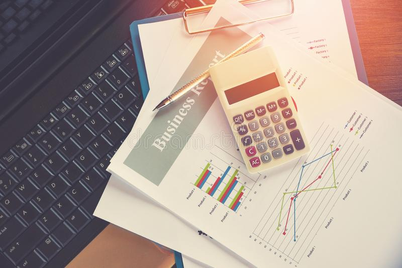 Business report chart preparing graphs calculator on laptop / Summary report in Statistics circle Pie chart on paper stock images