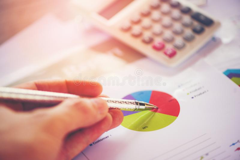 Business report chart preparing graphs calculator Summary report in Statistics circle Pie chart on paper stock photography