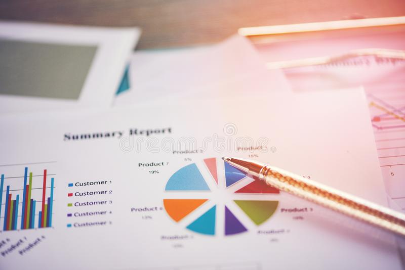 Business report chart preparing graphs concept Summary report in Statistics circle Pie chart on paper business document financial royalty free stock photo