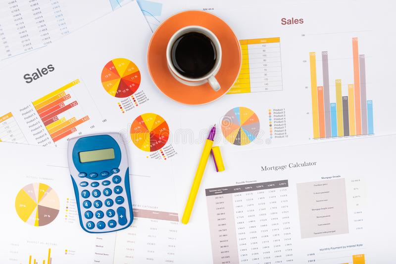 Business report. Cup of coffee on document. Accounting stock image