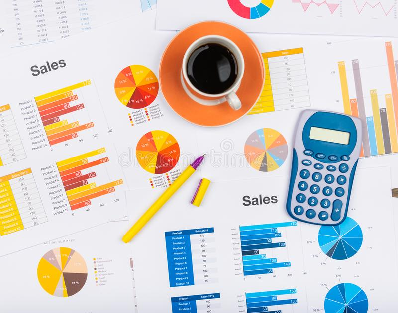 Business report. Cup of coffee on document. Accounting royalty free stock images