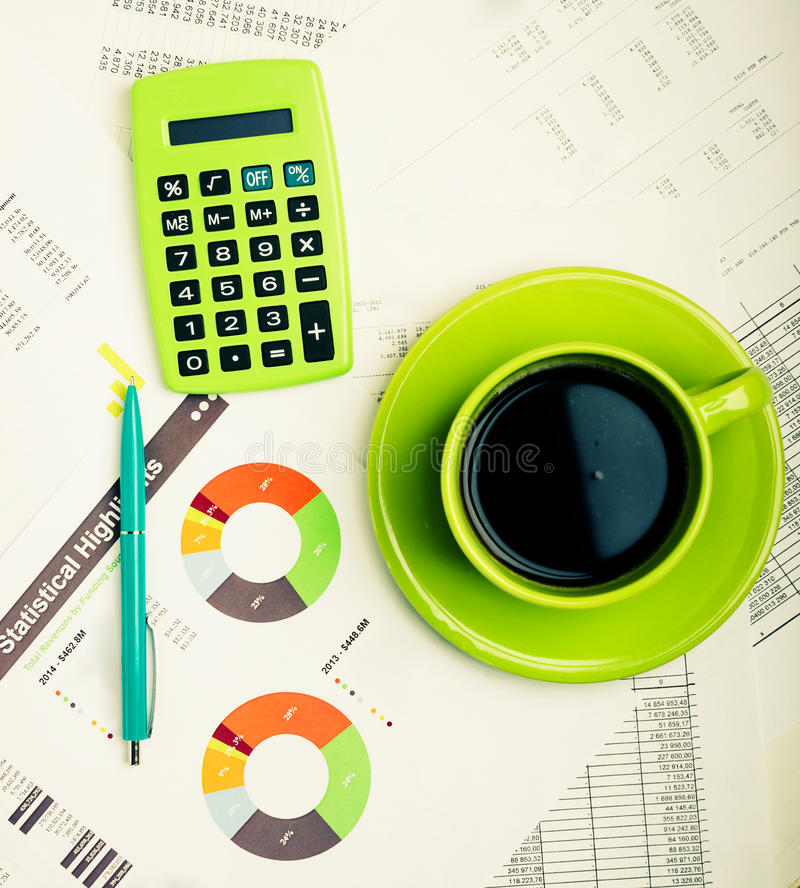 Business report. Cup of coffee on document. Accounting. Business still-life stock photography
