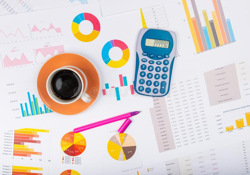 Business report. Cup of coffee on document. Accounting royalty free stock photo