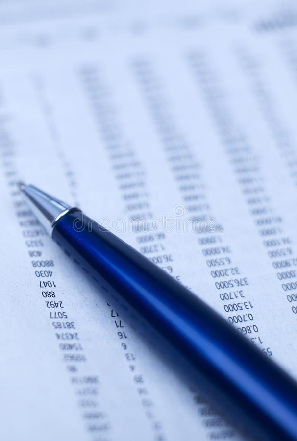 Business report and pen stock image