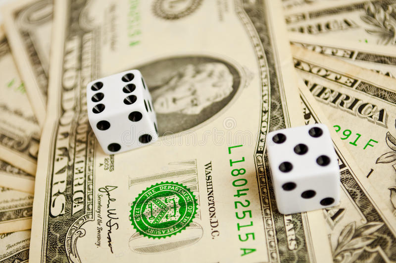 Business risk. Concept with dollars and two dices royalty free stock image