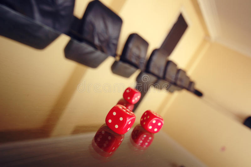 Business risk. Concept, risky business, red dices on the empty conference table focus is on the first dice in a row royalty free stock image
