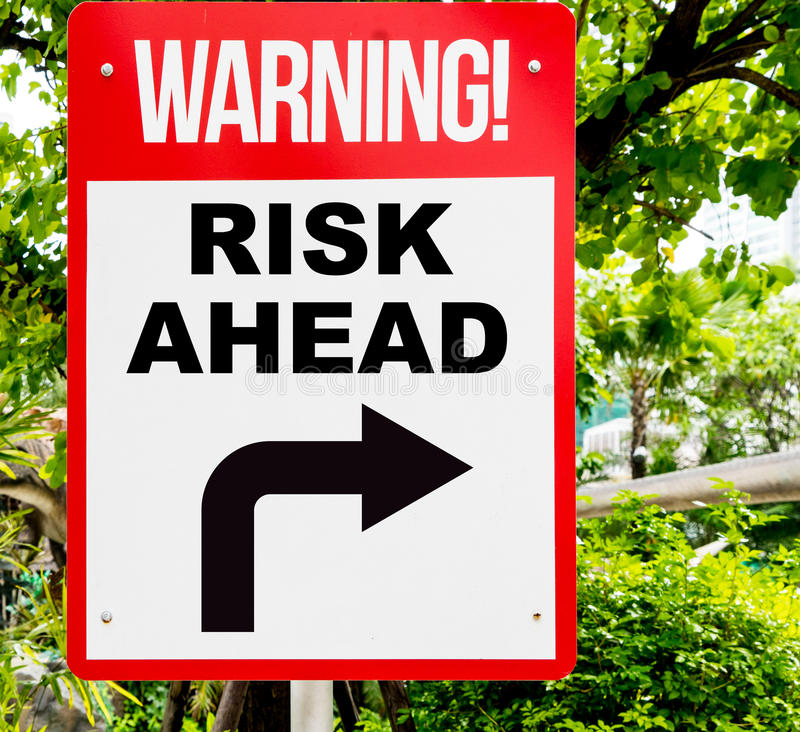 Business Risk Ahead warning sign turning right. Warning sign that warn you about the risk if you go on ahead. Making decision to take risk and go ahead to royalty free stock images