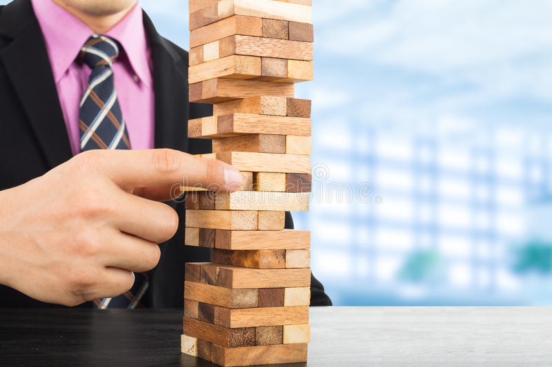 Business risk concept with wood jenga game. Businessman manage his strategy royalty free stock images