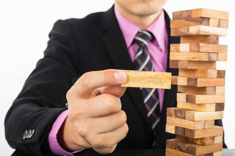 Business risk concept with wood jenga game. Businessman manage his strategy royalty free stock photos