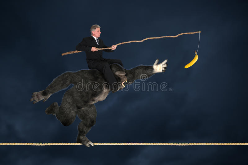 Business Risk Management Leadership Goals. Concept for business risk management, setting goals, sales, or marketing. A businessman is riding on the shoulders of royalty free stock photo
